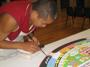 Tibetan monk working on the sand mandala, 1st October 2011