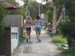 Two bikini gals walking up O'Brien St, just past intersection with Glenayre Ave, April 2011nue